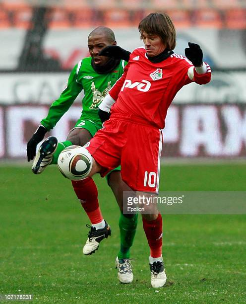 Dmitri Loskov of FC Lokomotiv Moscow in action against MacBeth Sibaya of FC Rubin Kazan during the Russian Football League Championship match between...