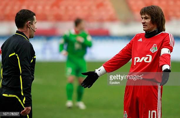 Dmitri Loskov of FC Lokomotiv Moscow talks to Referee Vyacheslav Popov during the Russian Football League Championship match between FC Lokomotiv...