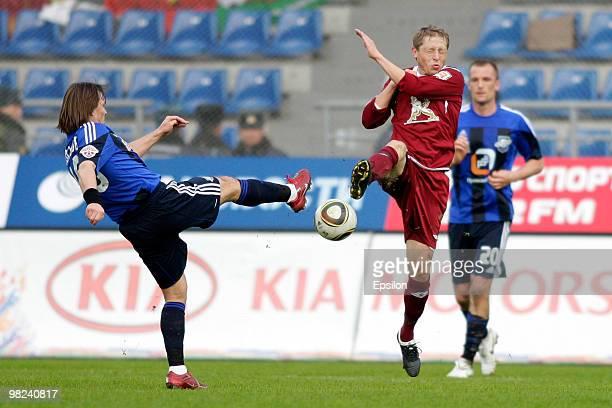 Dmitri Loskov of FC Saturn Moscow Oblast battles for the ball with Rafal Murawski of FC Rubin Kazan during the Russian Football League Championship...