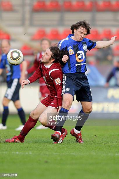 Dmitri Loskov of FC Saturn Moscow Oblast battles for the ball with Fatih Tekke of FC Rubin Kazan during the Russian Football League Championship...