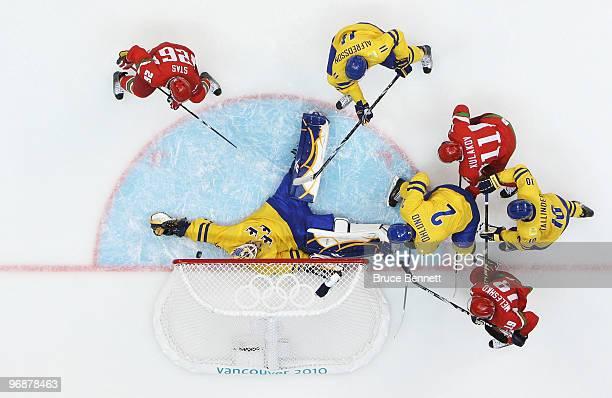 Dmitri Meleshko of Belarus scores a thirdperiod goal against goalkeeper Jonas Gustavsson of Sweden during the ice hockey men's preliminary game on...