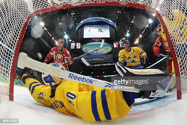 Dmitri Meleshko of Belarus scores against goalkeeper Jonas Gustavsson of Sweden during the ice hockey men's preliminary game on day 8 of the...