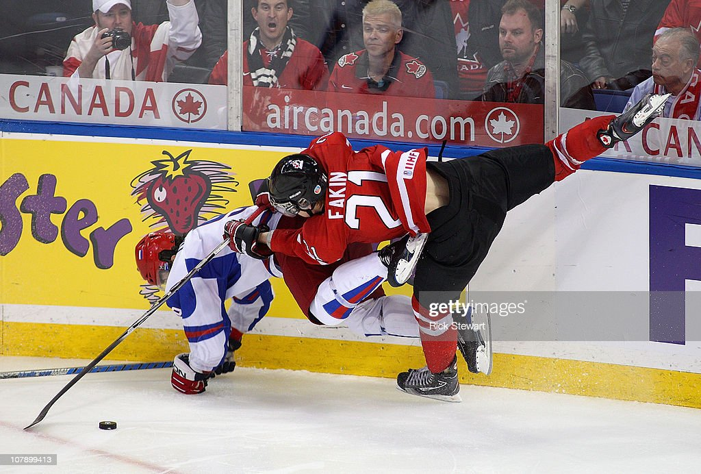 Dmitri Orlov #9 of Russia and Cody Eakin #21 of Canada collide in the air during the 2011 IIHF World U20 Championship Gold medal game between Canada and Russia on January 5, 2011 in Buffalo, New York. ussia won 5-3 to take the gold medal.