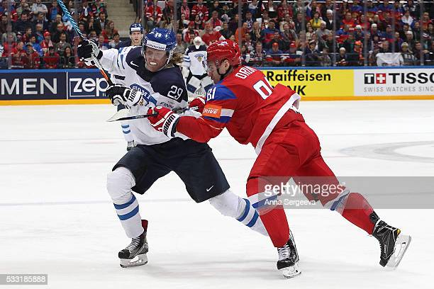 Dmitri Orlov of Russia hits Patrik Laine of Finland at Ice Palace on May 21 2016 in Moscow Russia Finland defeated Russia 31