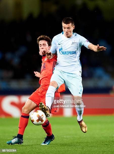 Dmitri Poloz of Zenit St Petersburg duels for the ball with Alvaro Odriozola of Real Sociedad during the UEFA Europa League group L football match...