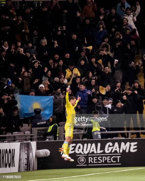 Dmitri Shomko of FK Astana celebrates scoring their first goal during the UEFA Europa League group L match between FK Astana and Manchester United at...