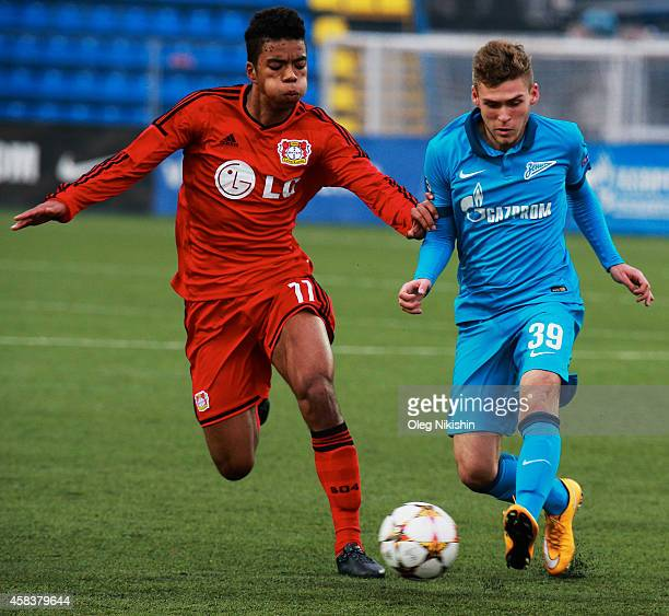 Dmitri Skopintsev of FC Zenit is challenged by Benjamin Henrichs of FC Leverkusen during the UEFA Youth League Group C match between FC Zenit St...