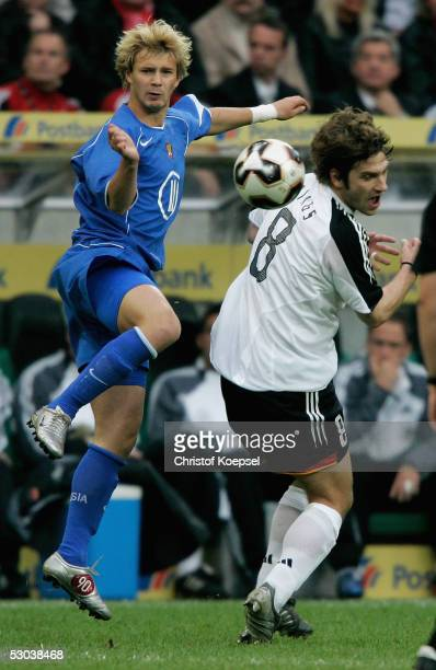 Dmitri Sychev of Russia tackles Torsten Frings of Germany during the friendly match between Germany and Russia on June 8 2005 in Monchengladbach...
