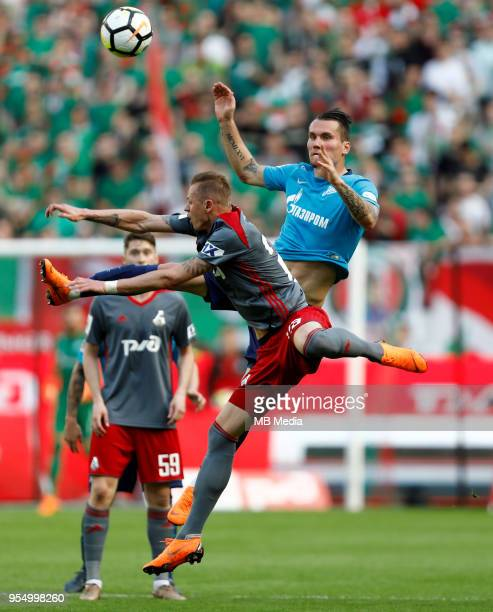 Dmitri Tarasov of FC Lokomotiv Moscow and Anton Zabolotny of FC Zenit Saint Petersburg vie for the ball during the Russian Football League match...
