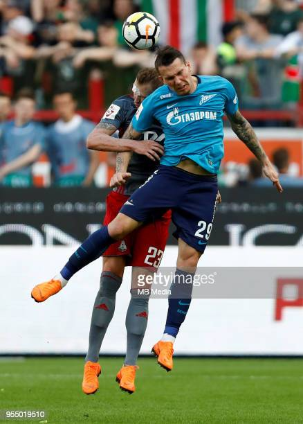 Dmitri Tarasov of FC Lokomotiv Moscow and Anton Zabolotny of FC Zenit Saint Petersburg vie for a header during the Russian Football League match...