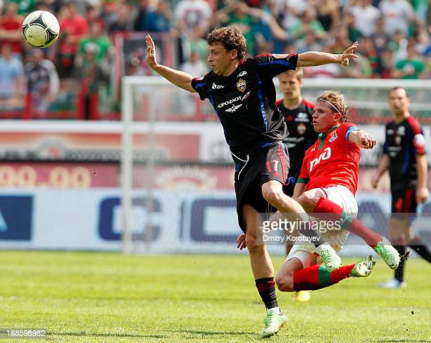 Dmitri Tarasov of FC Lokomotiv Moscow is challenged by Pavel Mamayev of PFC CSKA Moscow during the Russian Premier League match between FC Lokomotiv...