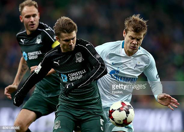 Dmitri Torbinski of FC Krasnodar is challenged by Aleksandr Kokorin of FC Zenit St Petersburg during the Russian Premier League match between FC...