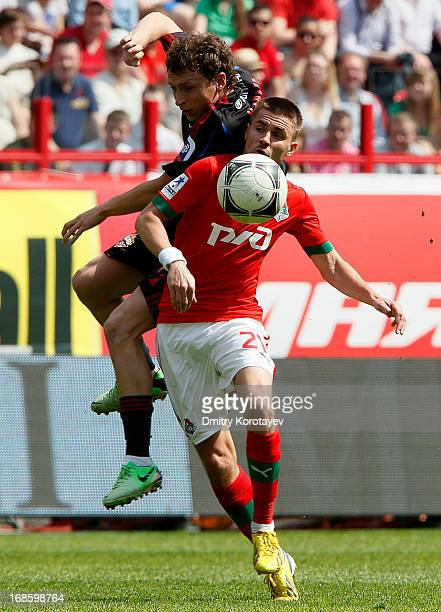 Dmitri Torbinski of FC Lokomotiv Moscow is challenged by Pavel Mamayev of PFC CSKA Moscow during the Russian Premier League match between FC...