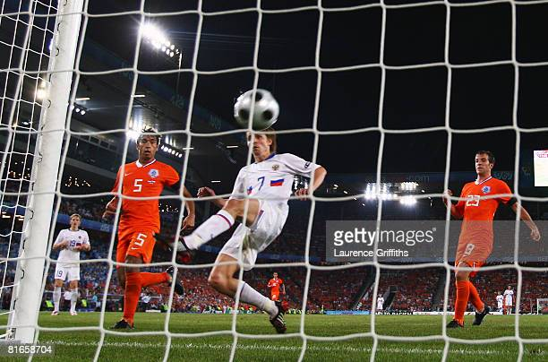 Dmitri Torbinskiy of Russia gets a foot to the ball and scores his teams second goal of the game during the UEFA EURO 2008 Quarter Final match...