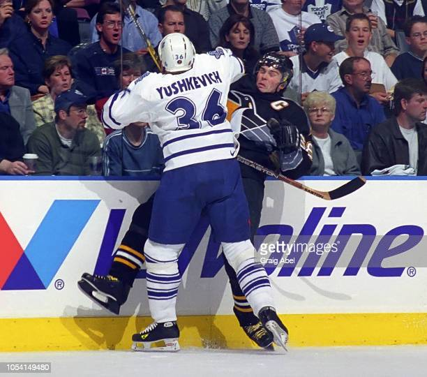 Dmitri Yushkevich of the Toronto Maple Leafs skates against Jaromir Jagr of the Pittsburgh Penguins during the 1999 Quarter Finals of the NHL playoff...