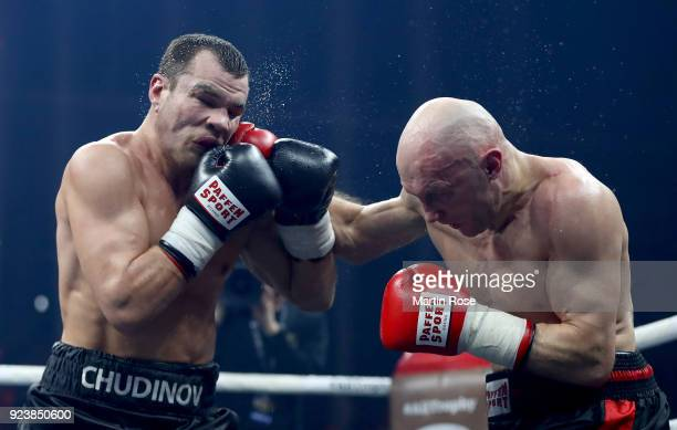 Dmitrii Chudinov Russia exchange punches with Siarhei Khamitski of Belarus during their super middleweigt fight at Arena Nurnberger at Arena...