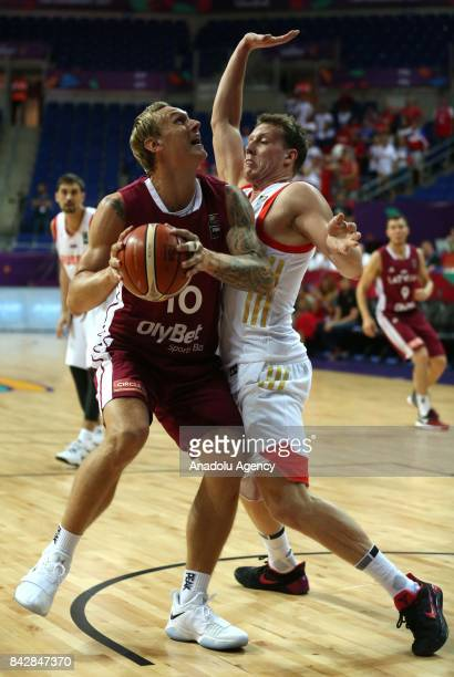 Dmitrii Kulagin of Russia in action against Janis Timma of Latvia during the FIBA Eurobasket 2017 Group D Men's basketball match between Russia and...
