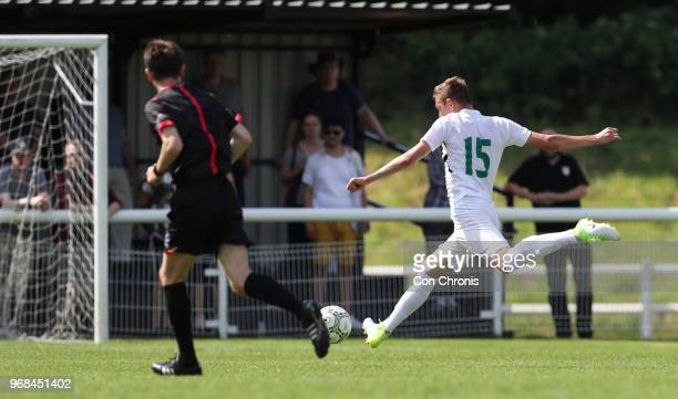 Dmitrii Maskaev of Abkhazia shoots and scores during the CONIFA World Football Cup 2018 match between Abkhazia and Northern Cyprus at Enfield Town on...