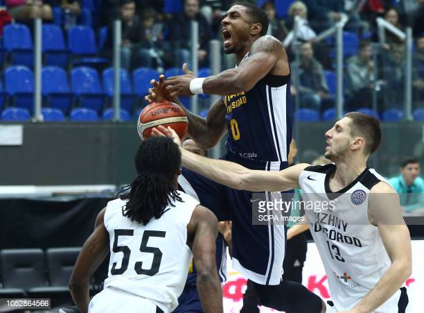 Dmitrii Uzinskii Kendrick Perry and Ovie Soko seen in action during the game Basketball Champions League BC Nizhny Novgorod from Russia vs Ucam...