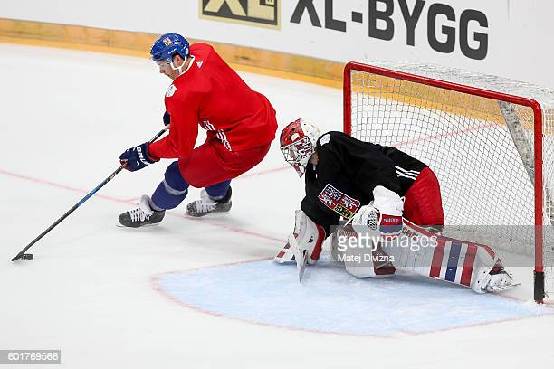 Dmitrij Jaskin of Czech Republic tries to score over Czech goalkeeper Michal Neuvirth during the morning skate before the 2016 World Cup of Hockey...