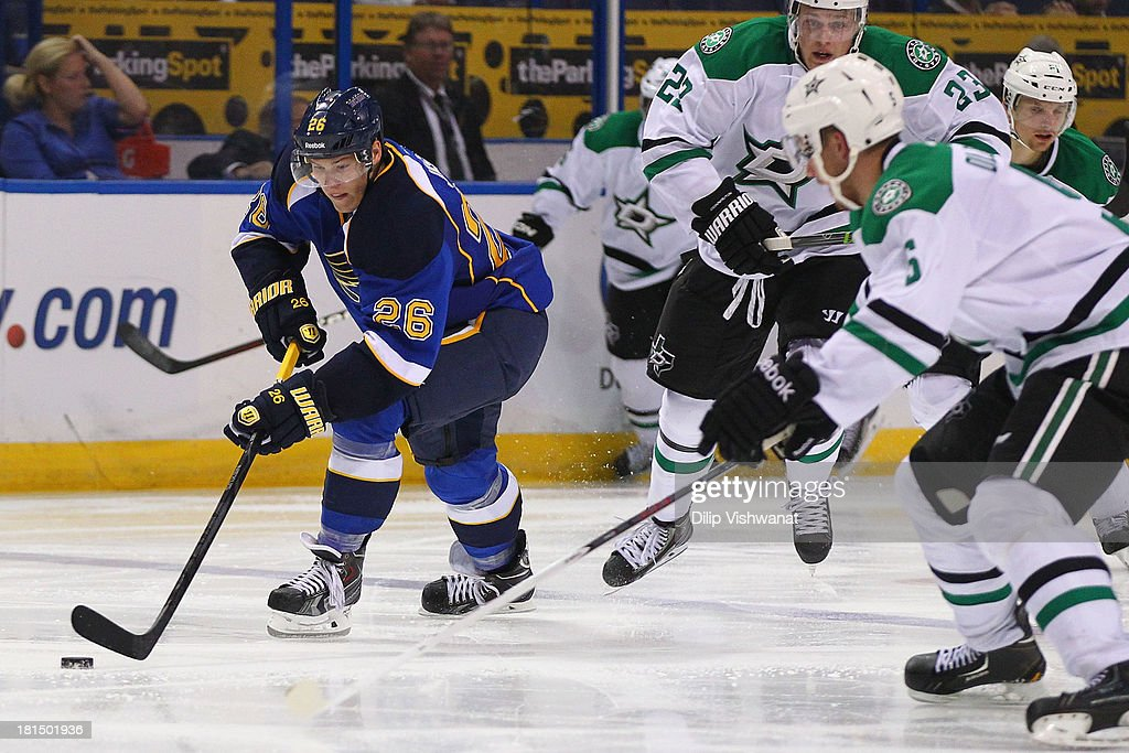 Dmitrij Jaskin #26 of the St. Louis Blues moves the the puck up ice against the Dallas Stars during a preseason at the Scottrade Center on September 21, 2013 in St. Louis, Missouri. The Blues beat the Stars 3-2 in overtime.