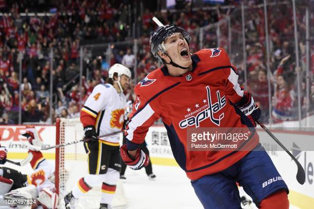 Dmitrij Jaskin of the Washington Capitals celebrates after scoring a goal in the first period against the Calgary Flames at Capital One Arena on...