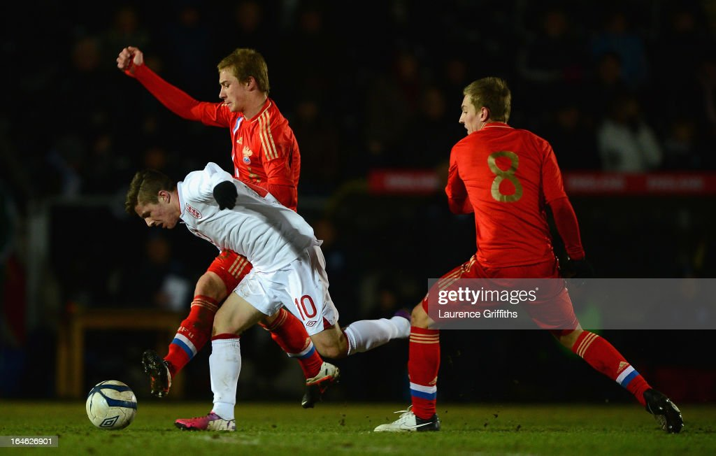 Dmitriy Barinov of Russia battles with Daniel Crowley of England during the UEFA European Under-17 Championship Elite Round match between England Under-17 and Russia U-17at Pirelli Stadium on March 25, 2013 in Burton-upon-Trent, England.