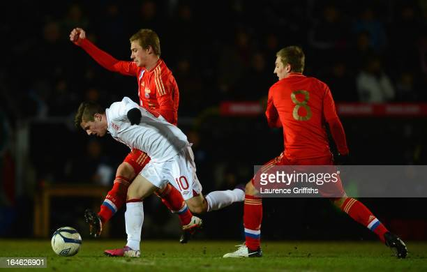Dmitriy Barinov of Russia battles with Daniel Crowley of England during the UEFA European Under17 Championship Elite Round match between England...