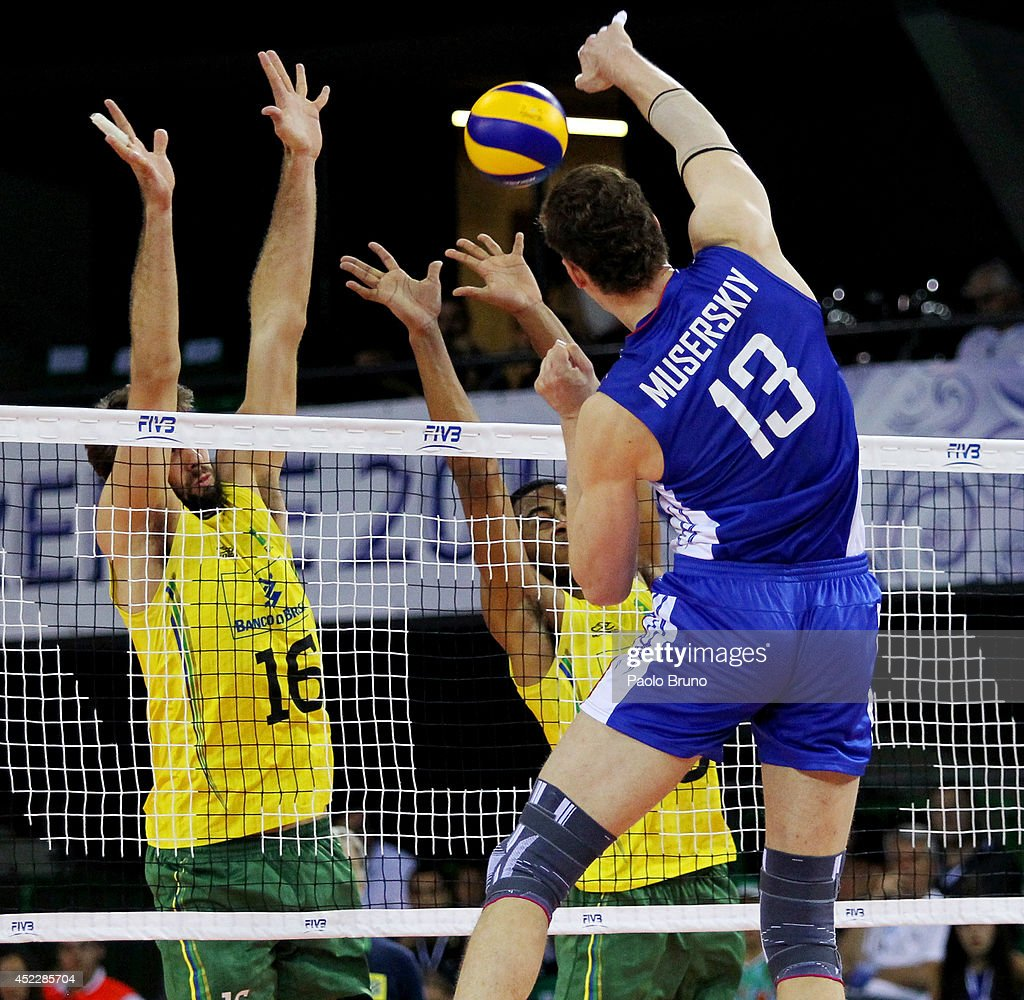 Dmitriy Muserskiy of Russia spikes the ball during the FIVB World League Final Six match between Russia and Brazil at Mandela Forum on July 17, 2014 in Florence, Italy.