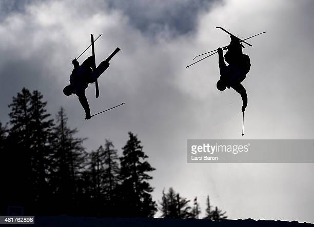 Dmitriy Reiherd of Kazakhstan competes with Aleksey Pavlenko of Russia during the Men's Dual Moguls Finals of the FIS Freestyle Ski and Snowboard...