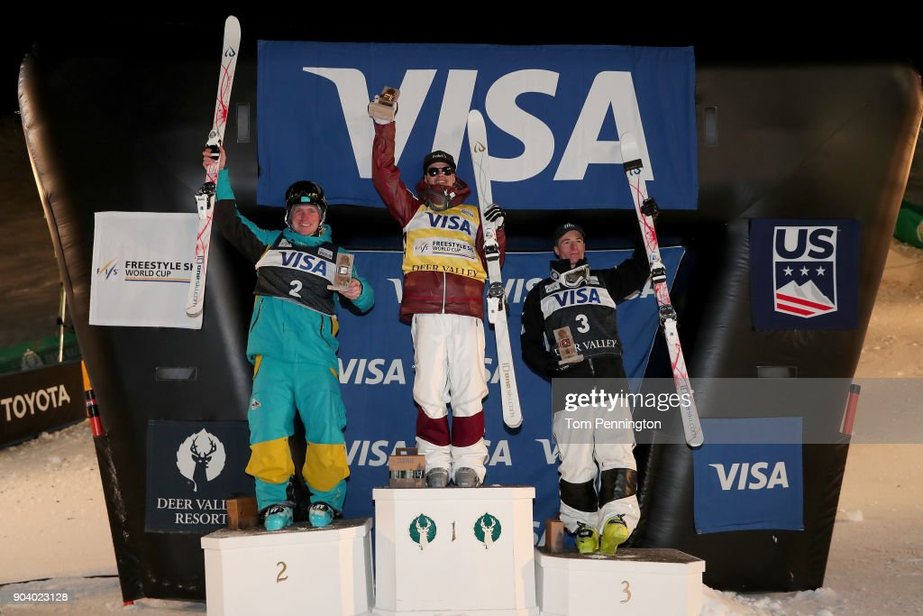 Dmitriy Reikherd of Kazakhstan in second place, Mikael Kingsbury of Canada in first place and Matt Graham of Australia in third place celebrate on the podium for the Men's Moguls Finals during the 2018 FIS Freestyle Ski World Cup at Deer Valley Resort on January 11, 2018 in Park City, Utah.