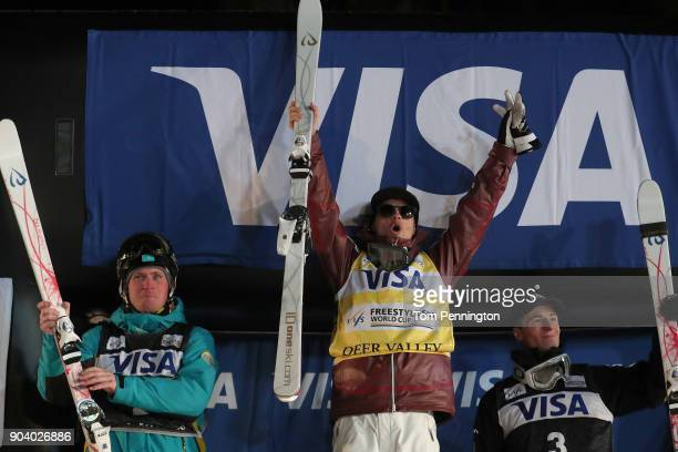 Dmitriy Reikherd of Kazakhstan in second place Mikael Kingsbury of Canada in first place and Matt Graham of Australia in third place celebrate on the...