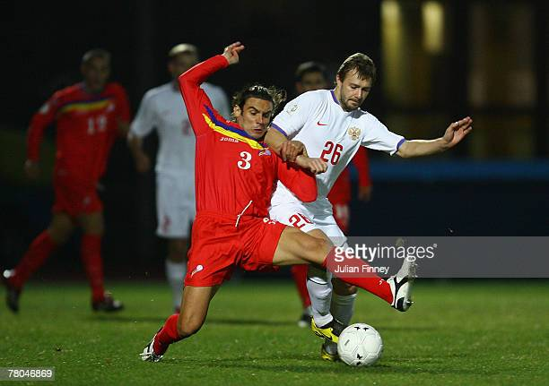 Dmitriy Syschev of Russia battles with Marc Bernaus of Andorra during the Euro2008 Qualifier match between Andorra and Russia at the Estadi Comunal...