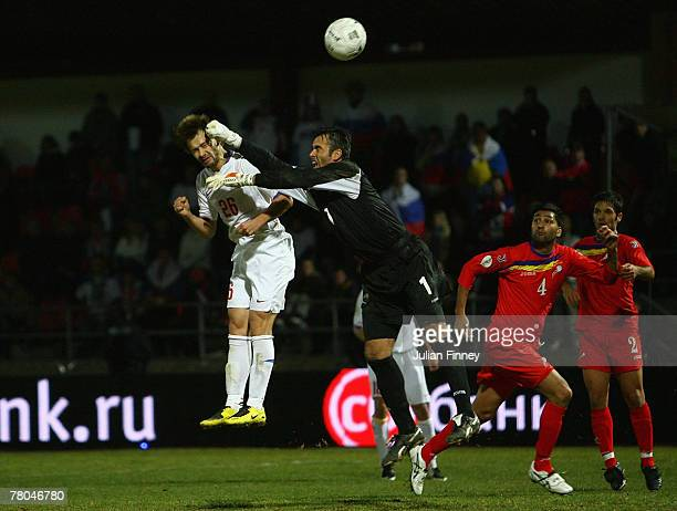 Dmitriy Syschev of Russia scores a header during the Euro2008 Qualifier match between Andorra and Russia at the Estadi Comunal on November 21 2007 in...