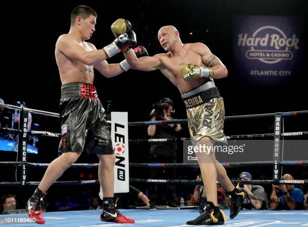 Dmitry Bivol and Isaac Chilemba exchange punches during the WBA Light Heavyweight Title bout at the Hard Rock Hotel Casino Atlantic City on August 4...