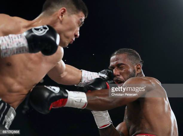 Dmitry Bivol connects with a left against Cedric Agnew during their light heavyweight championship bout at the Mandalay Bay Events Center on June 17...