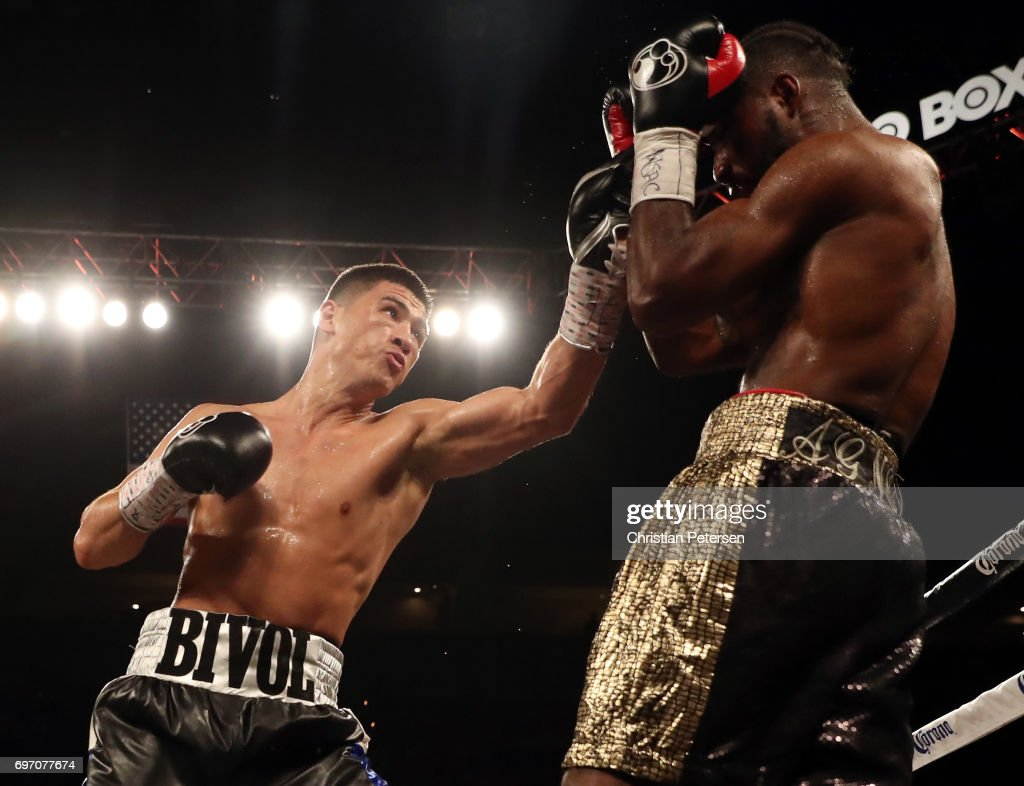 Dmitry Bivol (L) connects with a left against Cedric Agnew during their light heavyweight bout at the Mandalay Bay Events Center on June 17, 2017 in Las Vegas, Nevada. Bivol won by fourth-round TKO.