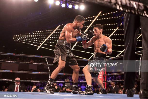 Dmitry Bivol defeats Sullivan Barrera by TKO in the 12th round during their Light Heavyweight fight at Madison Square Garden on March 3, 2018 in New...