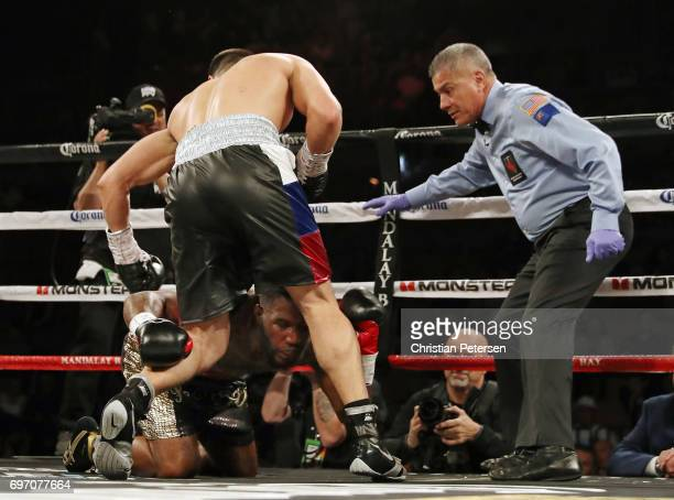 Dmitry Bivol stands over Cedric Agnew as referee Russell Mora looks on during their light heavyweight bout at the Mandalay Bay Events Center on June...