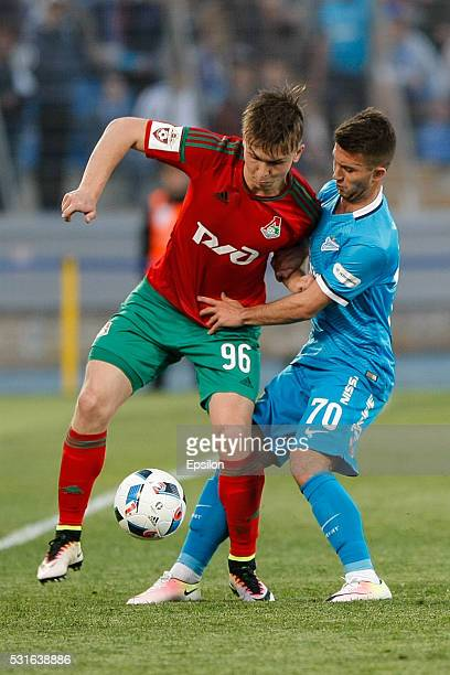 Dmitry Bogaev of FC Zenit St Petersburg and Rifat Zhemaletdinov of FC Lokomotiv Moscow vie for the ball during the Russian Football League match...