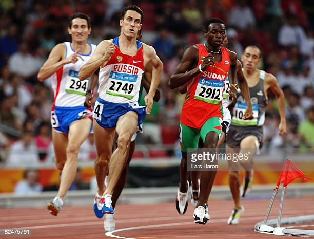 Dmitry Bogdanov of Russia and Abubaker Kaki of Sudan compete in the Men's 800m Heats held at the National Stadium during Day 12 of the Beijing 2008...