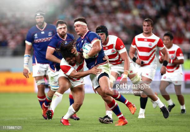 Dmitry Gerasimov of Russia is tackled by Shota Horie of Japan during the Rugby World Cup 2019 Group A game between Japan and Russia at the Tokyo...