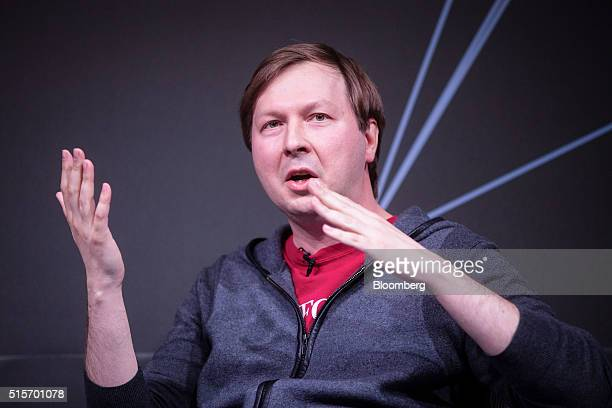 Dmitry Grishin chief executive officer of Mailru Group Ltd gestures as he speaks during the Goldman Sachs Disruptive Technology Symposium 2016 in...