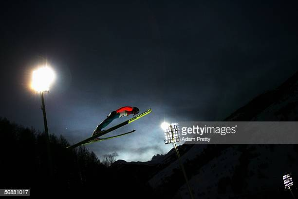 Dmitry Ipatov of Russia competes in the Large Hill Individual Ski Jumping Final on Day 8 of the 2006 Turin Winter Olympic Games on February 18 2006...