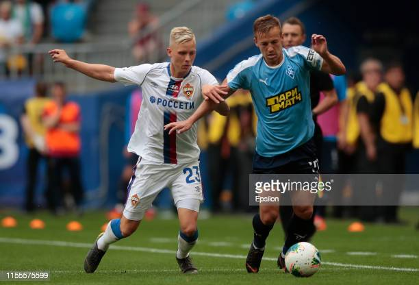 Dmitry Kabutov of FC Krylia Sovetov Samara and Hordur Magnusson of PFC CSKA Moscow vie for the ball during the Russian Premier League match between...