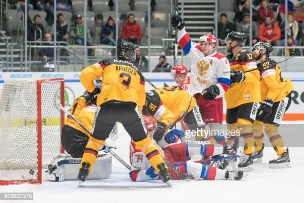 Dmitry Kagarlitsky of Russia scores the team`s fourth goal and Timo Pielmeier of Germany Justin Krueger of Germany Nikolai Prokhorkin of Russia...