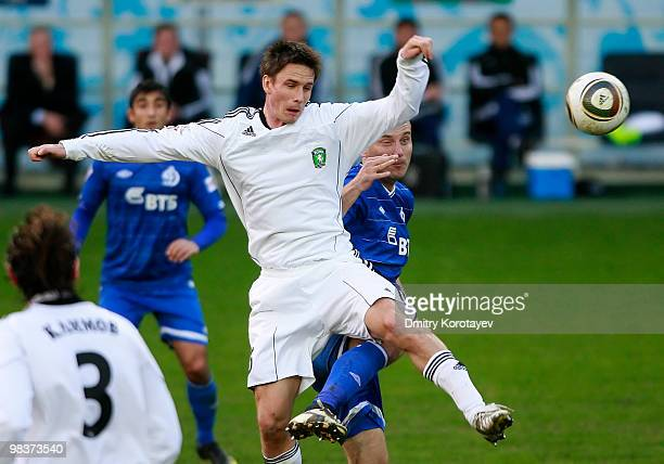 Dmitry Khokhlov of FC Dinamo Moskva battles for the ball with Dmitri Michkov of FC Tom Tomsk during the Russian Football League Championship match...