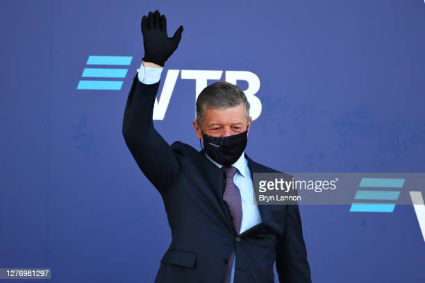 Dmitry Kozak Deputy Chief of Staff of the Presidential Executive Office waves from the podium during the F1 Grand Prix of Russia at Sochi Autodrom on...