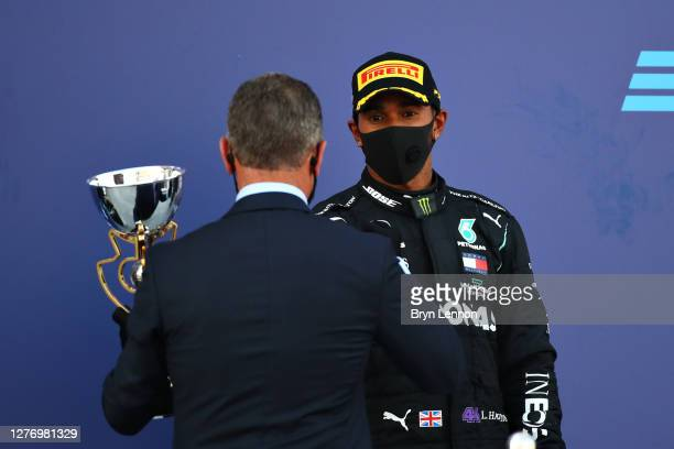 Dmitry Kozak Deputy Chief of Staff of the Presidential Executive Office presents Lewis Hamilton of Great Britain and Mercedes GP with his third place...