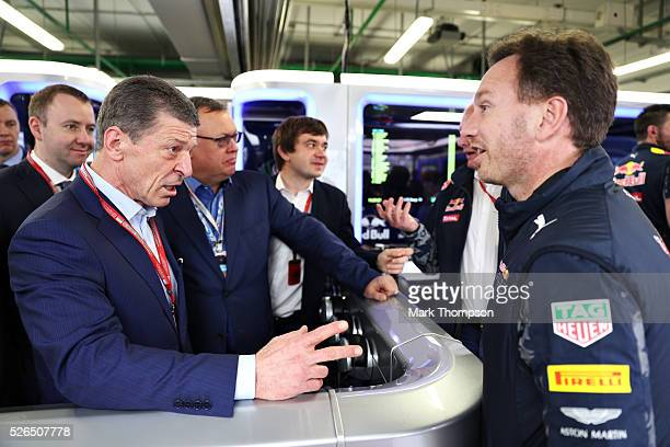 Dmitry Kozak Deputy Prime Minister of Russia talks to Red Bull Racing Team Principal Christian Horner in the garage during qualifying for the Formula...